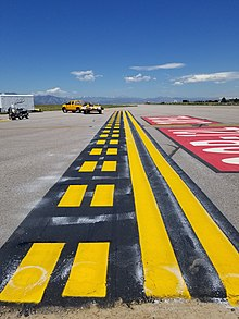 A newly painted Runway Holding Position Marking