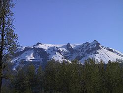 A snow-covered mountain with a jagged flattish top