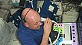 ISS-31 André Kuipers performs ultrasound eye imaging in the Columbus lab.jpg