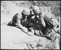 In bitter fighting on Hook Ridge, Marines threw back 800 screaming, bugle-blowing Chinese. A wounded Marine is given... - NARA - 532426.tif