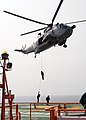 Indian Navy MARCOS slithering from a Sea King helicopter.jpg