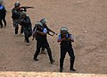 Iraqi Police students approach a building while rehearsing room clearing drills at the Police Academy in Basrah, Iraq, April 20, 2011 110420-A-YD132-011.jpg