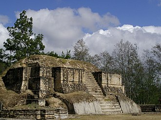 """Iximche - Temple 2 at Iximche and its itzompan (""""skull place"""") at bottom left"""