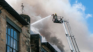 Scottish Fire and Rescue Service - SFRS firefighter douses flames at the Glasgow School of Art fire in May 2014