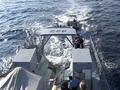 Jamaican patrol vessel retrieves pursuit boat.png