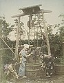 Japanese women in the 1890s, Drawing Water From the Well (3110741446) (cropped).jpg