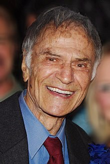Jerry Springer Larry Storch Geri Reischl 2011 David Shankbone (cropped).JPG