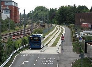 Transport in Cambridge - A guided bus entering the concrete busway track