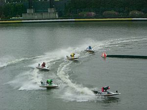 Kyōtei - BOAT RACE competitors fly around the corner at Suminoe.