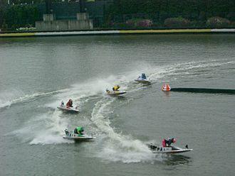 Kyōtei - BOAT RACE competitors fly around the corner at Suminoe.