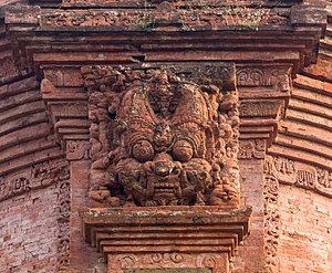 Kāla (time) - Head of Kala carved on top of Jabung temple niche, East Java.