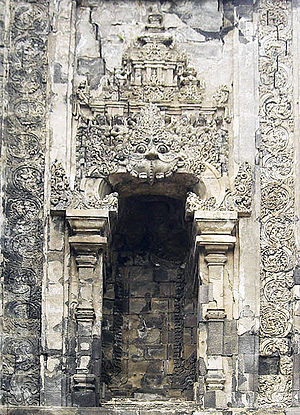 Kalasan - One of the niches on the wall of Kalasan temple adorned with carvings of Kala giant and scene of deities in svargaloka