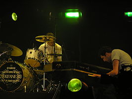 Tim Rice-Oxley playing his Yamaha CP70 piano alongside drummer Richard Hughes during the Tsunami Relief Cardiff concert