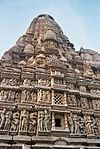Very tall stone structure decorated all over with sculptures.