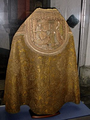 "Cope - Finely embroidered cope, Saint Bavo Cathedral, Ghent, 15th century. Note the shield-shaped ""hood""."