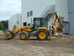 Backhoe loader - A typical European backhoe-loader; these usually have a side-shift backhoe mount and vertical stabilizers.