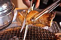 Korean barbecue - cutting a king oyster mushroom with scissors.jpg