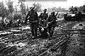 Kraljevo, German soldiers carrying dead soldier.jpg