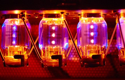 "The glow from four ""Electro Harmonix KT88"" brand power tubes lights up the inside of a Canadian-made Traynor YBA-200 bass guitar amplifier. Kt88 power tubes in traynor yba200 amplifier.jpg"