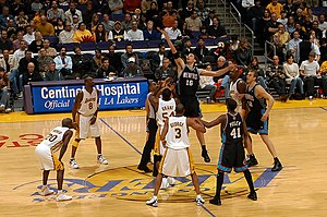 2003–04 Los Angeles Lakers season - Horace Grant battles for a jump ball versus Memphis Grizzlies Pau Gasol in November 2003.