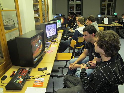 Students in Leipzig, Germany, playing the Master System. The system was very popular in Europe, selling 6.8 million units in that region. Lange Nacht der Computerspiele 1.JPG