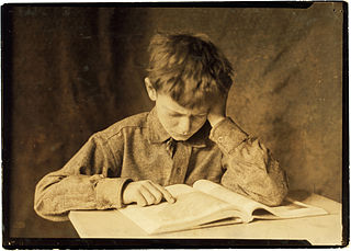 image of boy reading