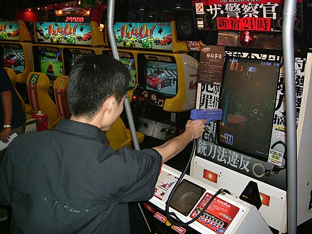 A police-themed arcade game in which players use a light gun Light gun survival horror arcade game.jpg