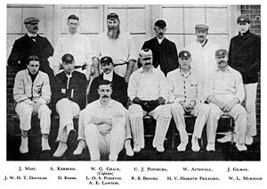 Hesketh-Prichard sits in an official cricket photograph surrounded by his team-mates