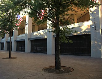 J. Edgar Hoover Building - The first floor of the J. Edgar Hoover Building on Pennsylvania Avenue NW. The FBI opposed an arcade and retail shops here; the final design features a windowless wall with black granite infill panels at street level.