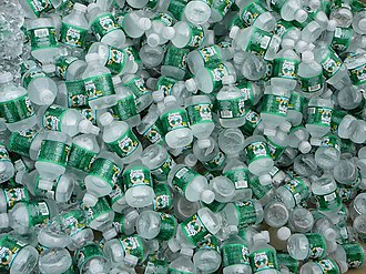 Poland Spring - A large pile of half-pint Poland Spring bottles
