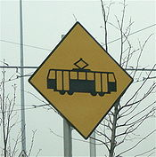 Yellow tram signs warn pedestrians and motorists of Luas track ahead.