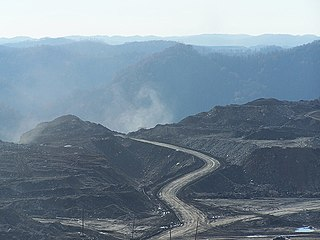 Mountaintop removal mining form of surface mining that involves the mining of the summit or summit ridge of a mountain