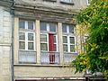Magny-en-Vexin (95), balcon du café de la Renaissance, architecte Charles Duval, XIXe s., place de la Halle.jpg