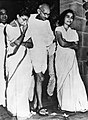 Mahatma Gandhi in the garden of his home with Abha Gandhi and Dr Sushila Nayyar.jpg