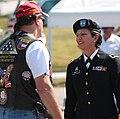 Maj. Gen. Britt and Patriot Guard Rider (6145025152).jpg
