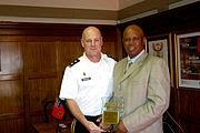 Maj. Gen. Patrick J. Donahue, commander of U.S. Army Africa, presents a plaque to Maj. Gen. Luvuyo Nobanda