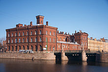 Malo-Kalinkin Bridge in Saint Petersburg with a Building.jpg