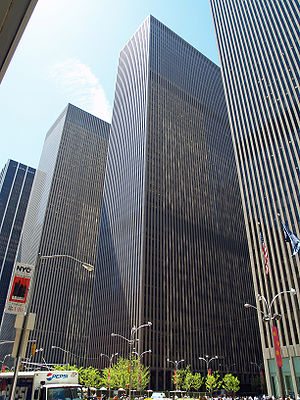 International Council of Shopping Centers - Headquarters of the International Council of Shopping Centers at 1221 Avenue of the Americas (middle skyscraper) in Midtown Manhattan, New York City, United States.