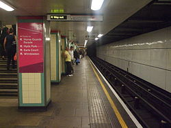 Mile End tube stn eastbound Central look west2 2012.JPG
