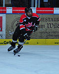 Military hockey teams skate at European tournament 140221-D-SK857-002.jpg