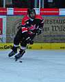 Military hockey teams skate at European tournament 140221-D-SK857-002.jpg