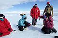 Miller Range, Antarctica - Examining a new find.jpg