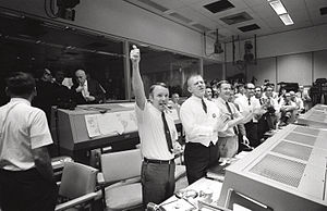 Gerald D. Griffin - Griffin (l) and other flight directors celebrate the Apollo 13 splashdown April 17, 1970