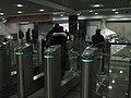 Mitino station entry, turnstiles (Вход на станцию Митино, турникеты) (4323540672).jpg