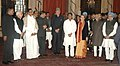 Mohd. Hamid Ansari, the Prime Minister, Dr. Manmohan Singh, the Chairperson, National Advisory Council, Smt. Sonia Gandhi, the Union Ministers and other dignitaries with the new Cabinet Minister, Shri Ajit Singh.jpg
