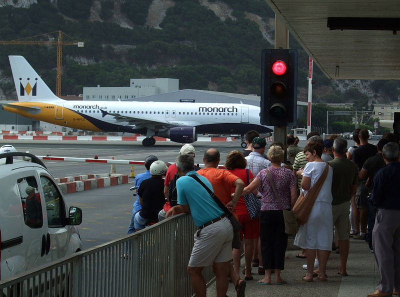 Berkas:Monarch Airlines aeroplane taxiing on Gibraltar Airport's runway, Winston Churchill Avenue, Gibraltar.jpg