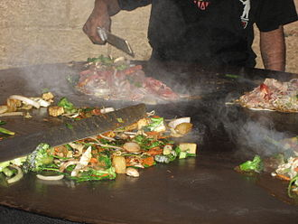 Mongolian barbecue - Food cooking on a Mongolian barbecue griddle