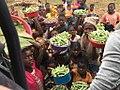 Mozambican Men and Women Selling Okra and other vegetables.jpg