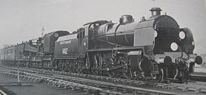 SECR N class - An official Southern Railway photograph of No. 1412 coupled to a breakdown crane in 1938. This was one of the final batch of N class locomotives built, and was equipped for left-hand drive.