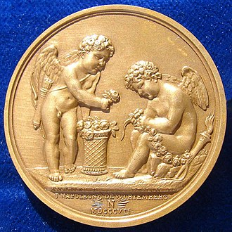 Hymen (god) - Cupid standing (left), and Hymen sitting (right). Hymen's burning torch on a Napoleonic wedding medal of 1807. It commemorates the marriage of Napoleon's youngest brother Jérôme Bonaparte to Princess Catharina of Württemberg at Fontainebleau.